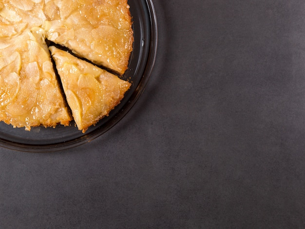 Homemade apple pie on a stone countertop.