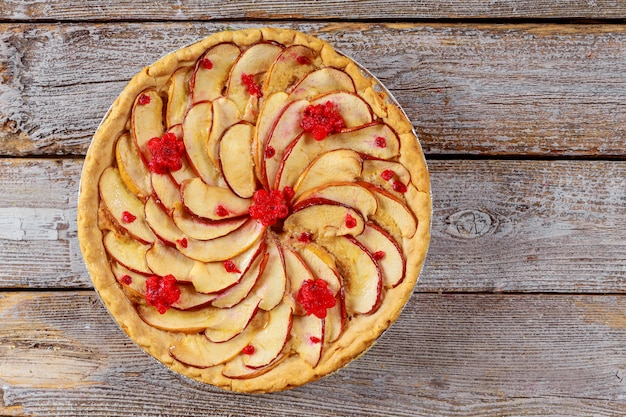 Homemade apple pie with sliced apple. top view