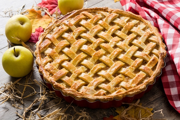 Homemade apple pie on wooden table