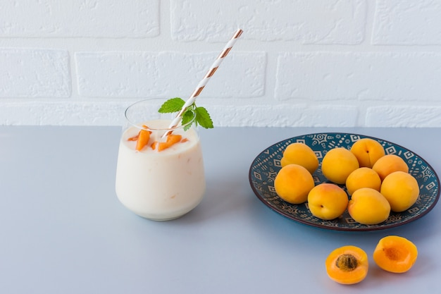 Homemade apricot smoothie and fresh apricots. healthy delicious snack.