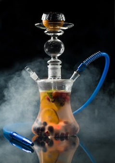 Homemade arabic shisha with mixed fruits and berries in a steam