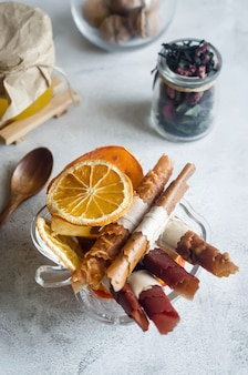 Homemade assorted fruit leather and dried chips in plate on wooden table