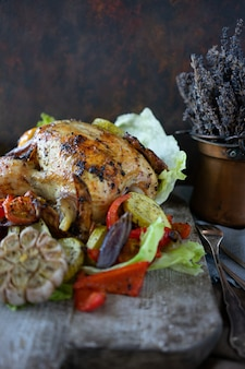 Homemade baked chicken with aroma herbs and vegetable salad