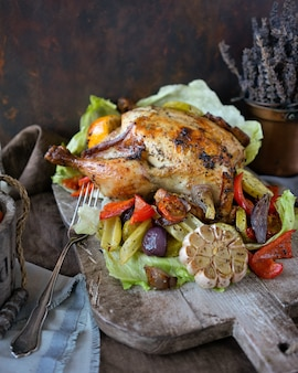 Homemade baked chicken with aroma herbs and vegetables salad
