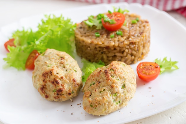 Homemade baked cutlets with rice on a table in a rustic style. healthy food
