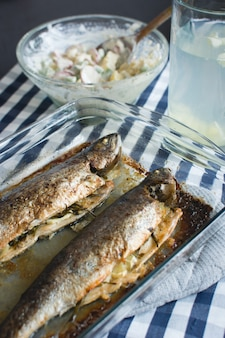 Homemade baked fish with potato salad
