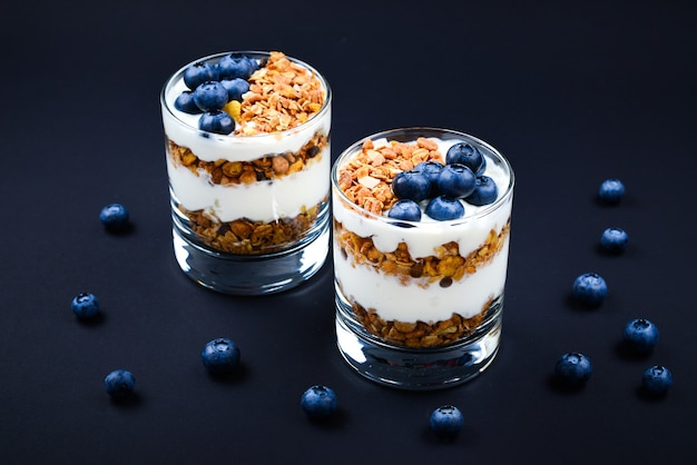 Homemade baked granola with yogurt and blueberries in a glass