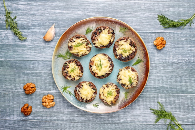 Homemade baked stuffed champignon mushrooms with fresh dill and cheese