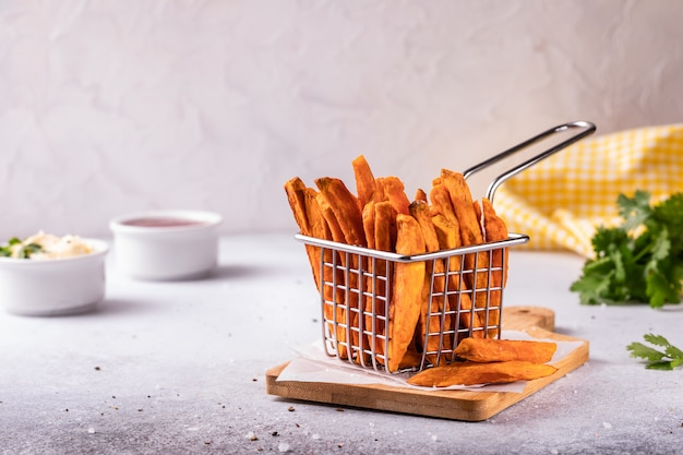 Homemade baked sweet potato french fries with ketchup