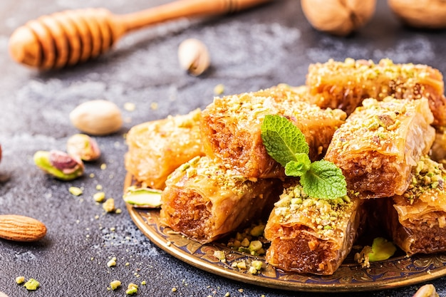 Homemade baklava with nuts and honey, selective focus.
