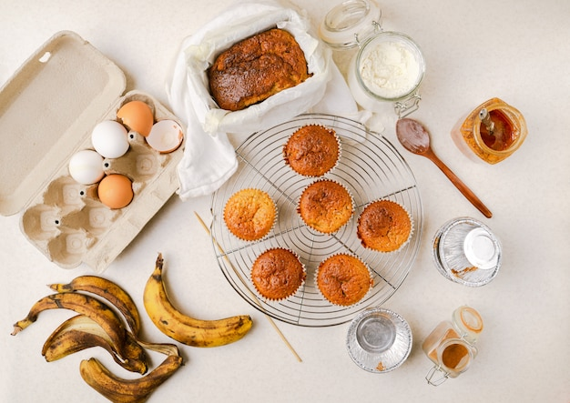 Homemade banana and honey muffins, banana bread, various ingredients, top view