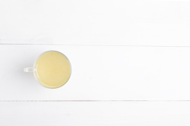 Homemade beef, chicken, tyrkey, pork bone broth in glass on a white background. top view with copy space