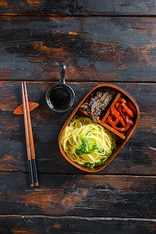 Homemade bento pack lunch, grilled beef and noodles