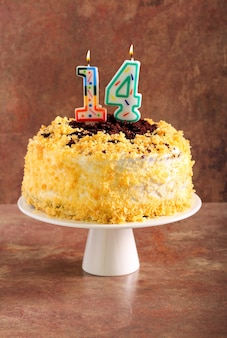 Homemade birthday cake with number candles 14