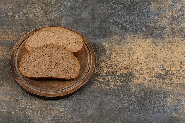 Homemade black bread on wooden board
