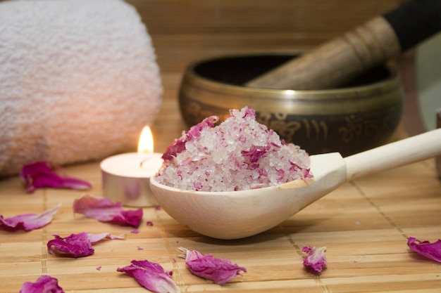 Homemade body scrub from sea salt and rose petals and peony