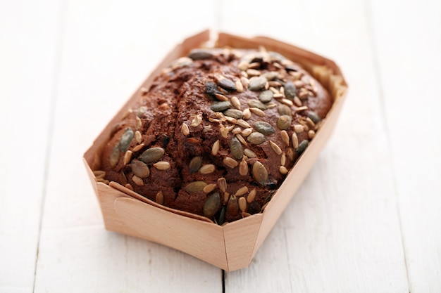 Homemade bread with grains in a box