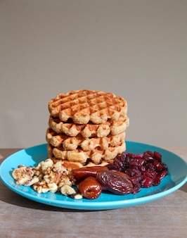 Homemade breakfast - oatmeal wafers with dried fruits and  nuts