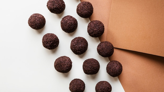 Homemade brigadeiro on white and brown background
