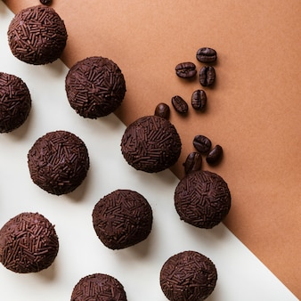Homemade brigadeiro with coffee beans on dual backdrop