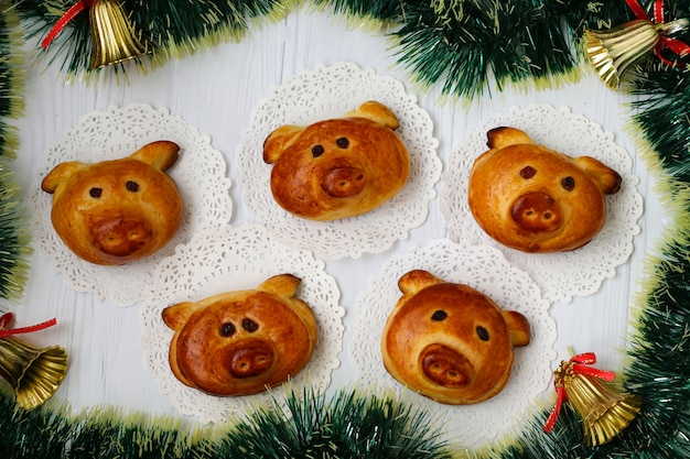 Homemade buns piglets on a white background, horizontal orientation