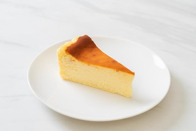 Homemade burn cheesecake on white plate