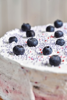 Homemade cake with berries. wooden background.