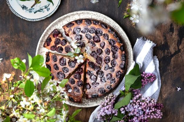 Homemade cake with cherries, ricotta and powdered sugar