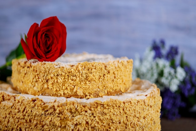Homemade cake with crushed nuts and flowers