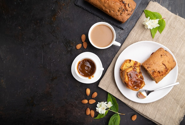 Homemade cake with raisins, almonds, soft caramel and a cup of coffee
