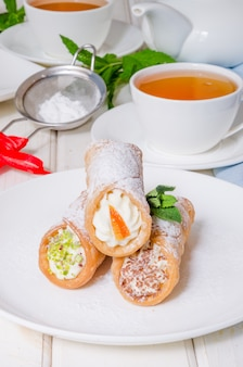 Homemade cannoli stuffed with ricotta cheese cream