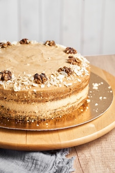 Homemade caramel cake on table. wooden background.