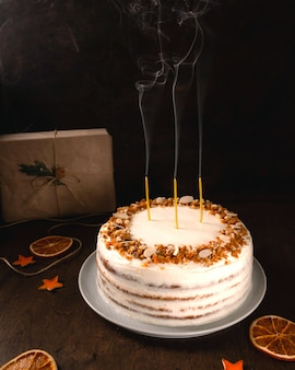 Homemade carrot cake with candles, close-up