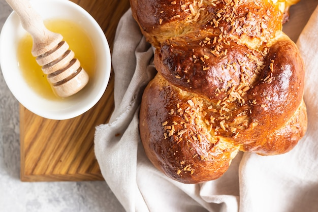 Homemade challah bread on a wooden cutting board