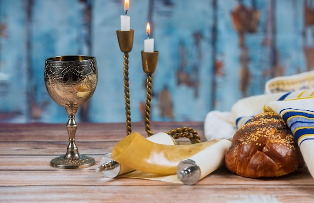 Homemade challah, wine and candles for shabbat