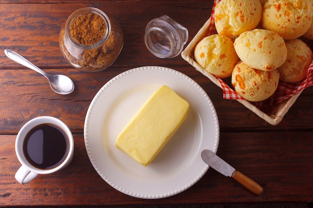 Homemade cheese bread, traditional brazilian snack, on the breakfast table in a rustic farm kitchen