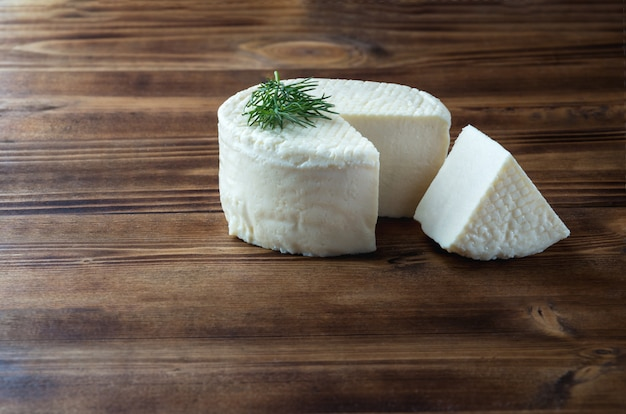 Homemade cheese wheel and dill