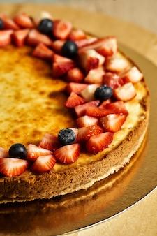 Homemade cheesecake cake on table.