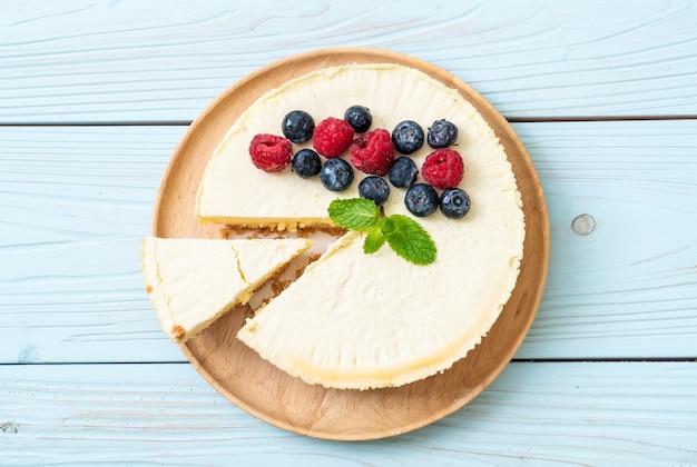 Homemade cheesecake with raspberries and blueberries