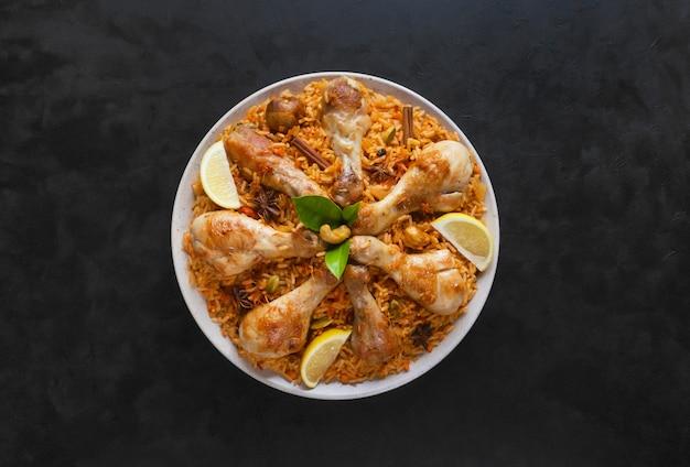 Homemade chicken biryani on a blue surface
