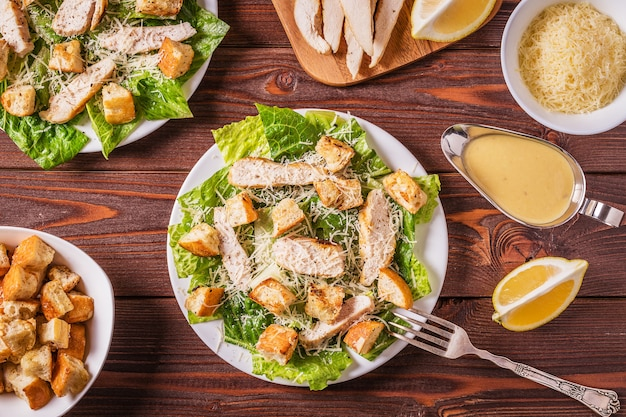 Homemade chicken caesar salad with cheese and croutons