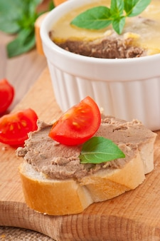Homemade chicken liver pate, basil and slices of white bread