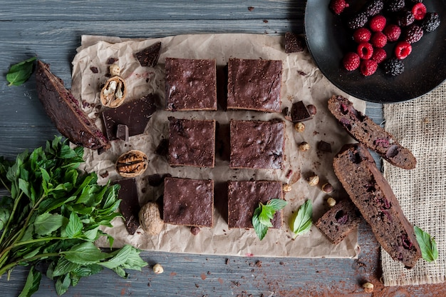 Homemade chocolate brownies on dark surface.
