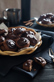 Homemade chocolate cookies with tea on dark table