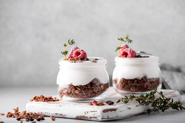 Homemade chocolate granola with yoghurt and fresh berries, close-up