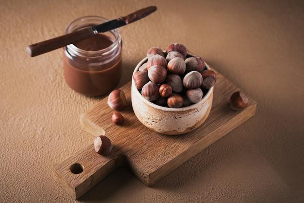Homemade chocolate hazelnut milk spread on a brown surface