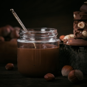 Homemade chocolate hazelnut milk spread on a dark background