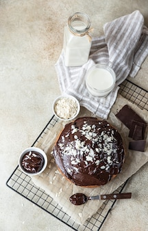 Homemade chocolate and vanilla cake decorated with chocolate glaze and nuts marble cake
