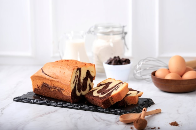 Homemade chocolate and vanilla marble loaf cake. sliced served with tea or coffe.