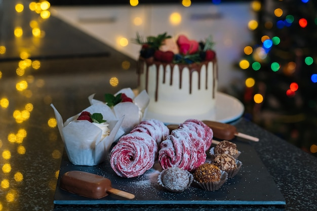 Homemade christmas baked assorted sweets. happy new year and merry christmas background. winter
